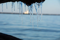 Icy light house. In Lake Eire it was last last few days of winter Royalty Free Stock Image