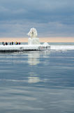 Icy lighthouse and tourists Stock Photography