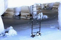Icy metal ladder Stock Images