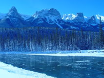 Icy mountain river. Blue sky above ice laden mountain river, clear and cold after the previous evening's snowstorm Stock Photos