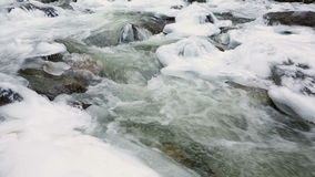 Icy Mountain Stream dolly shot stock video footage