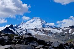 Icy mountain top with crevasses and rocks. Royalty Free Stock Photos