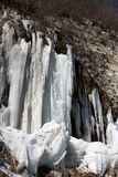 Icy mountain waterfall at nice sun day. Winter in Georgia Stock Image