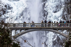 Icy Multnomah Falls December 2016. Multnomah, Oregon - December 17: Polar vortex at the end of 2016 bringing extreme low temperatures and tourists to view Stock Photos