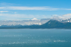 Icy Ocean and Mountains Stock Photo