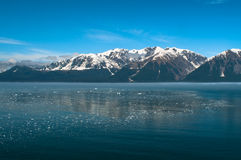 Icy Ocean and Snowy Mountains Stock Image