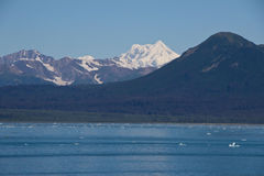 Icy Ocean Water and Alaskan Mountains Royalty Free Stock Images