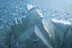 Icy pattern on glass. Frosty pattern on winter window stock photo