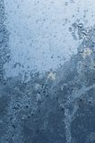 Icy pattern on glass. Frosty pattern on winter window Stock Image
