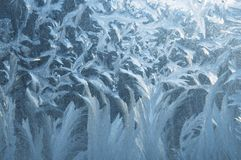 Icy pattern on glass. An icy pattern on a window in winter Royalty Free Stock Photo