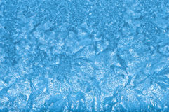 Icy pattern on glass Stock Photos
