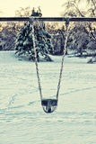 Icy Playground Swing Seat - Retro Royalty Free Stock Photography