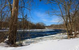 Icy rapids in the Farmington River in winter. Winter landscape featuring the rapids in the Farmington River in Windsor, Connecticut Stock Image