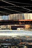 Icy river water chunks under a low-angle view of a frozen Chicago River in January Royalty Free Stock Photos