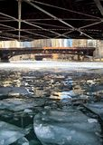 Icy river water in a low-angle view of a frozen Chicago River in January Royalty Free Stock Photo