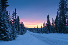 Icy road. From Lapland. Day light is very limited during January. Copy space on the top stock images