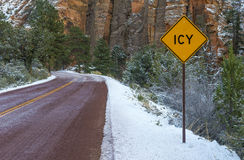 Icy road. Landscape with road in winter forest and road sign ICY stock images