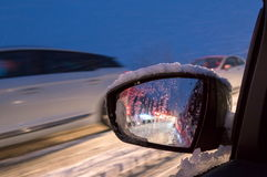 Icy road at night with cars Royalty Free Stock Photography