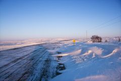 Icy road and snowy landscape. Stock Photography