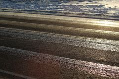 Icy road in sunlight Royalty Free Stock Photography
