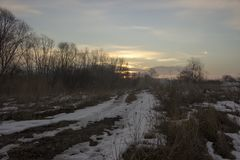 Icy road at sunrise. Landscape with an icy road at sunrise stock photos