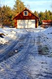 Icy road to the wooden garage Stock Images