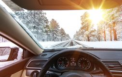 Icy Road Winter Drive. Winter Conditions on the Road with Sunny Sky. Driver View royalty free stock photography