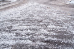 Icy road in a winter`s day. Ice covered road royalty free stock photo