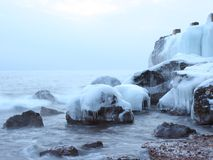 Icy rocks on the shore Royalty Free Stock Image