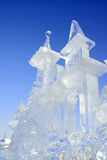 Icy sculpture. Against the blue background Royalty Free Stock Photography