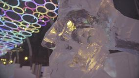 Icy sculpture of frozen Woodman or man with beard in winter city. Ice Sculptures in Russia. Sculptures In The Ice town stock footage