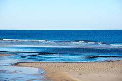 Icy sea beach with first ice pieces. In baltic sea. latvia Royalty Free Stock Photography