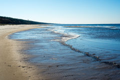 Icy sea beach with first ice pieces. In baltic sea. latvia Stock Photos