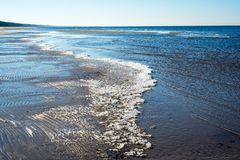 Icy sea beach with first ice pieces. In baltic sea. latvia Stock Photography