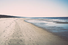Icy sea beach with first ice pieces. Vintage. Royalty Free Stock Image