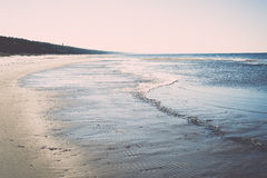 Icy sea beach with first ice pieces. Vintage. Royalty Free Stock Photos
