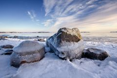 Icy sea and rocks Royalty Free Stock Photography