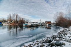 Icy shipyard bay. Winter season royalty free stock image