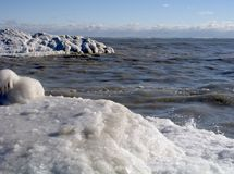 Icy Shore 15. Ocean waves crash along an icy shoreline stock image