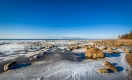 Icy shore landscape Stock Photos