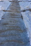 Icy sidewalk and gravel Stock Image