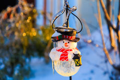 Icy snowman light. Icy snowman solar light in sunset Stock Images