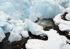 Icy and snowy creek stock photography