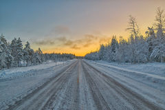 Icy and snowy winter road in Lapland, Finland Royalty Free Stock Photos