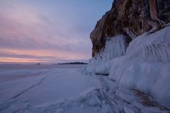 The icy splashes on the rock at dawn light. Splash out ice on the rock at dawn light, winter lake Baikal, cape Oltrec Royalty Free Stock Photo