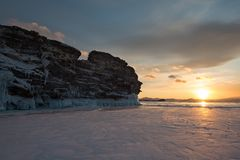 The icy splashes splash out ice on the cape at dawn light. The icy splashes splash out ice on the rock at dawn light, winter lake Baikal Stock Photography
