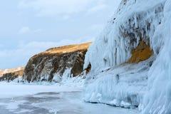 The icy splashes splash out ice on the rock. The icy splashes splash out ice on the island, winter lake Baikal Stock Photography
