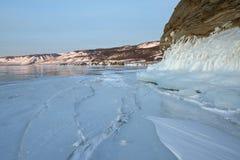 The icy splashes splash out ice on the rock, mountains. Winter lake Baikal Stock Image