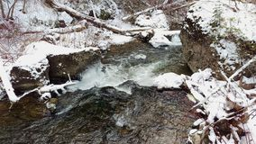 An Icy Stream Flowing Across a Frozen Landscape. Fifth water hot springs trail, Utah, US stock photo