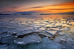 Icy sunset. Morning dawn with frozen ice floats in coast of Helsinki Royalty Free Stock Photos